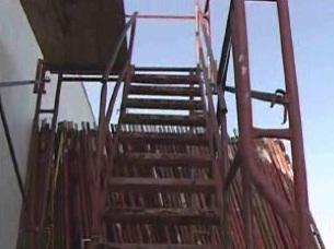 How to access a scaffold with the use of a stairway tower.