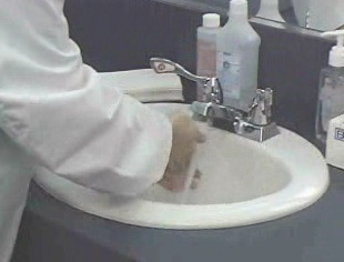 The use of gloves and hand washing when exposed to potential bloodborne pathogen contamination.