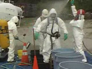 How worker decontamination should proceed after a spill has been cleaned up.